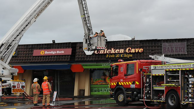 Firefighters at the Fulham Gardens shopping centre, where a fire destroyed seven businesses. Picture: Mark Brake