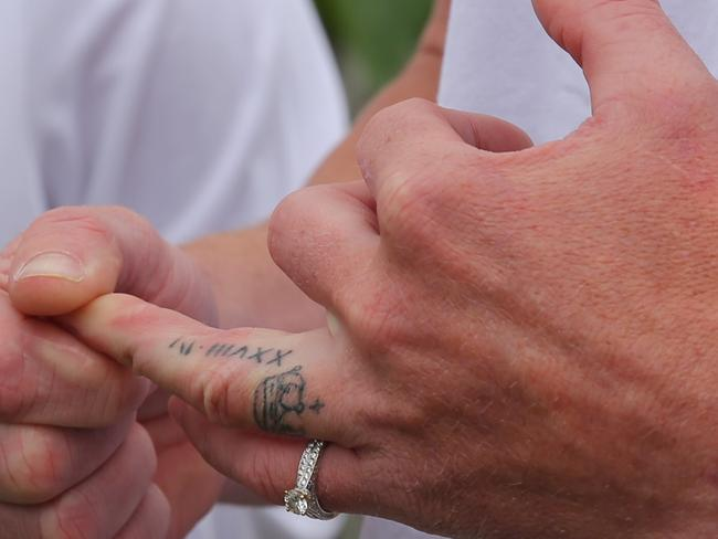 Chase Clarke shows his wedding tattoo while wearing Kelly's ring after she died in Fiji. Picture: John Grainger