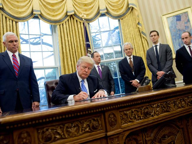 US President Donald Trump signs an executive order in the Oval Office of the White House regarding abortion — without a single woman present. Picture: AFP