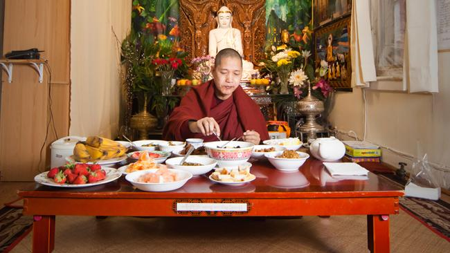 U Pa Mok Kha is a monk from Myanmar who cannot eat after 12 noon. Local people bring him food and after he is done, he shares the rest of the food with them. Age: 55. Time: 11:17 AM. Location: Jackson Heights, Queens. Photo: Miho Aikawa.