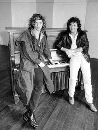 Former friends ... Michael Hutchence and Jimmy Barnes hang out at rehearsals for Australian Made. Picture: Simon Bullard