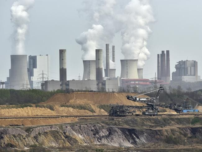 Giant machines dig for brown coal at the open-cast mining Garzweiler in front of a power plant near the city of Grevenbroich in western Germany. Picture: Martin Meissner/AP