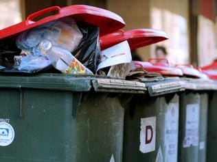 Rubbish bins are overloaded in the city as Melbourne City and Yarra councils strike. Wheelie bins. Garbage bins.