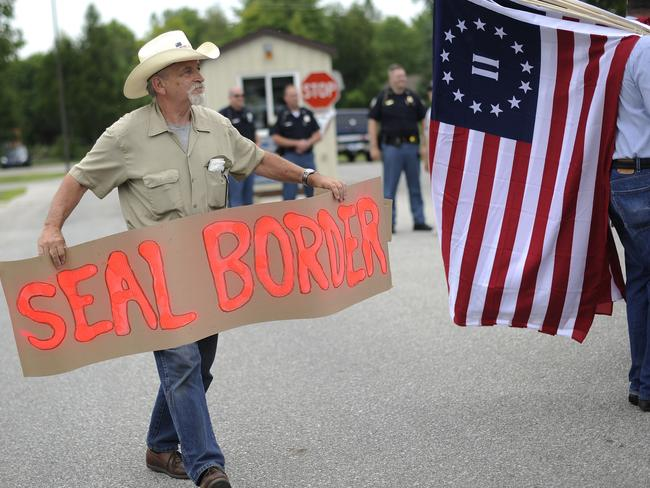 Making a stand ... Leszek Sulanowski, from Deford, Michigan, holds up a sign calling for a secured border during a protest. Picture: Detroit News, Elizabeth Conley