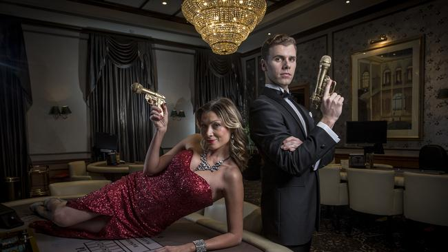 Looking suave...singers Debora Krizak and Blake Bowden join the Adelaide Symphone Orchestra tonight to perform the musical hits from James Bond films.