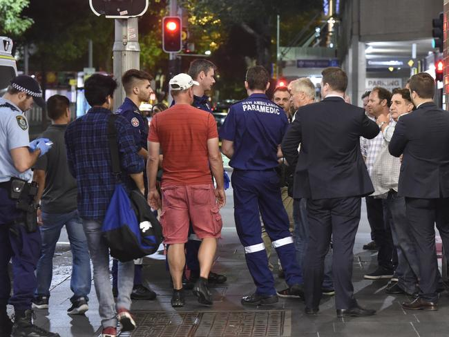 Paramedics and police on scene after the assault. Picture: Gordon McComiskie
