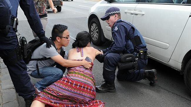 East West protesters 'running into traffic'