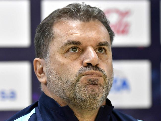 (FILES) This file photo taken on November 9, 2017 shows Australia's head coach Ange Postecoglou looking on  during a press conference at the Olimpico Metropolitano stadium in San Pedro Sula, Honduras, the day before the first leg football match of their 2018 FIFA World Cup qualifying play-off against Australia. Coach Ange Postecoglou said on November 22, 2017, he will not take Australia to the World Cup next year, ending weeks of speculation about his future after a lengthy qualification campaign.  / AFP PHOTO / JOHAN ORDONEZ