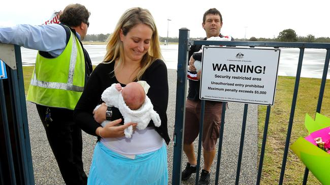 Kempsey couple Adam and Kate Osborne arrive at Port Macquarie airport from Bangkok with their Thai surrogate twin babies Mali and Sierra-Leone. Pic Nathan Edwards