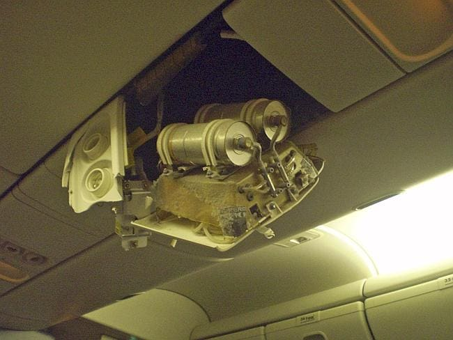 Part of the interior of a Continental Airlines plane is shown damaged after the jet hit turbulence in 2009. More than two dozen people were hurt. Picture: AP