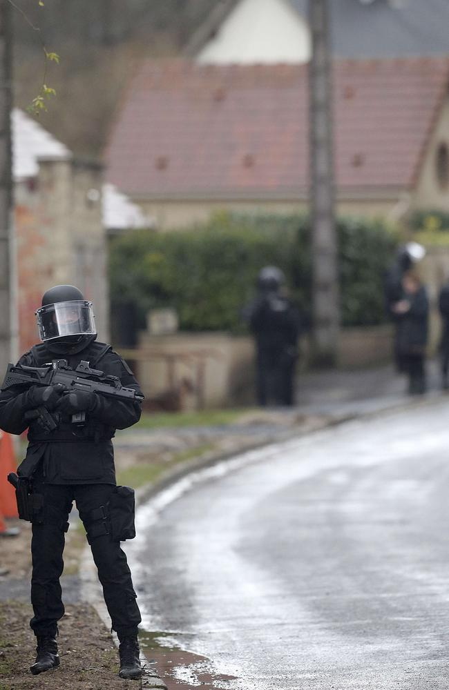 A member of France's special forces near Villers-Cotterets, north-east of Paris as police go door-to-door to hunt for France's most-wanted men. Picture: AFP/FRANCOIS NASCIMBENI.