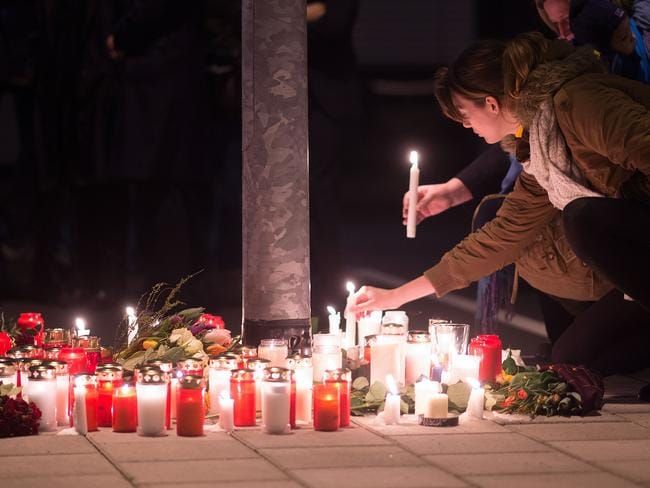 Staff members of Germanwings and Lufthansa hold a candlelight vigil at Dusseldorf Airport. Pic: Marius Becker