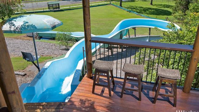 Brisbane home with waterslide for sale for Pool home show brisbane