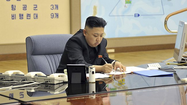 This photo taken and released by North Korea's official Korean Central News Agency (KCNA) on March 29, 2013 shows North Korean leader Kim Jong-Un looking at and signing documents at an undisclosed location. North Korean state media issued two photos that, either by accident or design, appeared to show plans for striking the US mainland, as well as details of the North's military strength. Picture: AFP