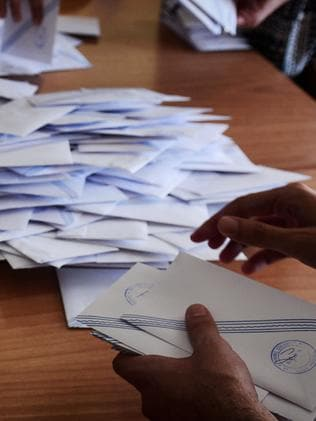 Polling station officials count ballots. Picture: Louisa Gouliamaki