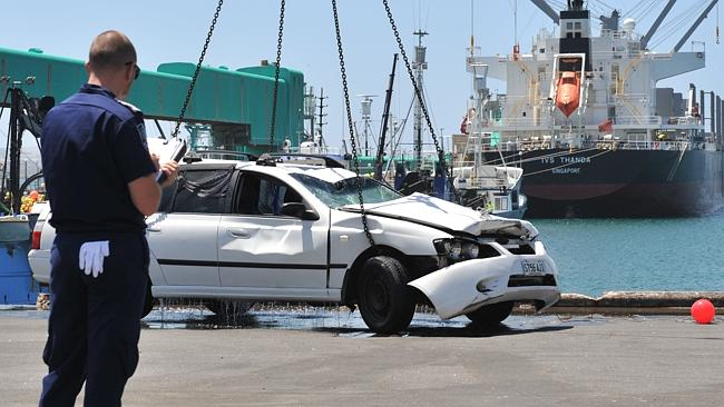 The Ford Falcon station wagon is lifted from the water onto the Port Lincoln wharf. Picture: Ivon Perrin