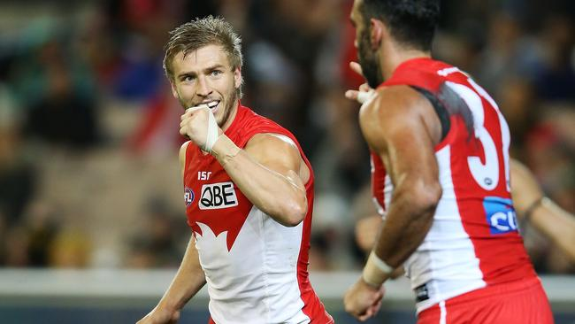 Kieren Jack celebrates a goal with Adam Goodes.