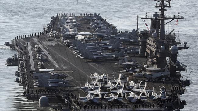 US Navy aircraft carrier, the USS Carl Vinson is departing the South China Sea to provide a physical presence near the Korean Peninsula.