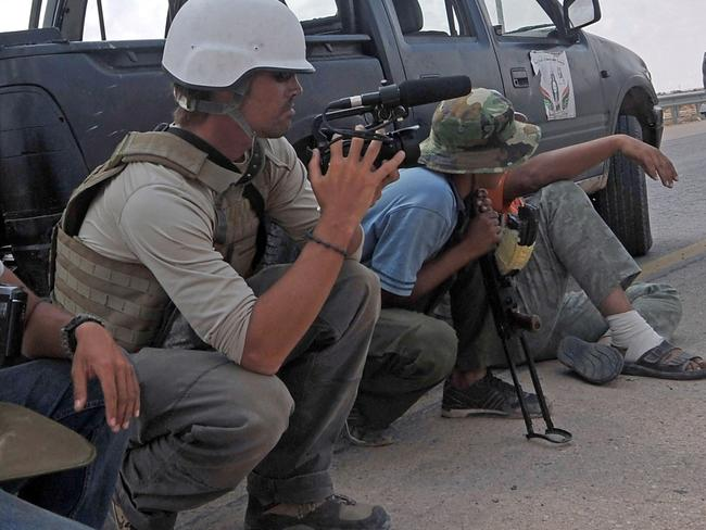 Slain US freelance reporter James Foley (L) on assignment in Sirte, Libya in 2011. picture: AFP
