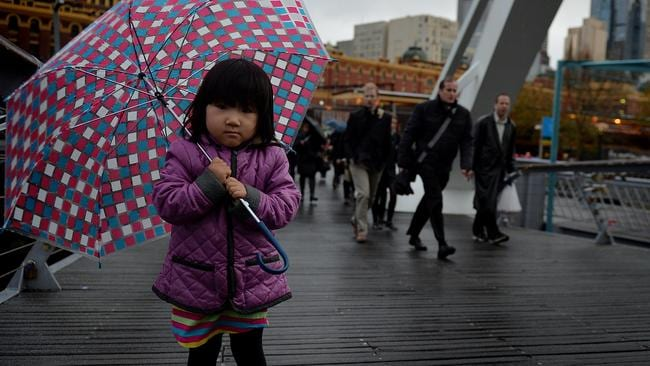 Little Mia, 4, held tightly on to her umbrella in Southbank on her way to kindergarten. Picture: Nicole Garmston