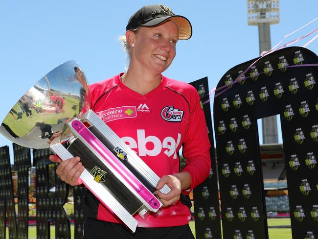 Alyssa Healy of the Sixers holds the trophy after winning the WBBL T20 Grand Final.