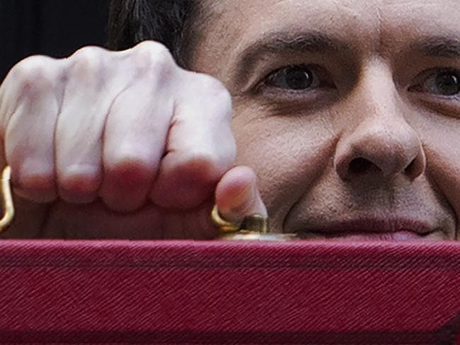 British Finance Minister George Osborne with the Budget papers in a red briefcase. Picture: AFP/ JUSTIN TALLIS