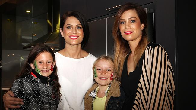 Alisa and Lysandra with fans Enya Talbot, 10 and Sienna Stuart-Williams in the girls apartment.