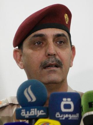 Iraqi army Brigadier General Yahya Rasool, spokesman of the Iraqi Joint Operations Command co-ordinating anti-jihadist efforts. Picture: AFP/Sabah Arar
