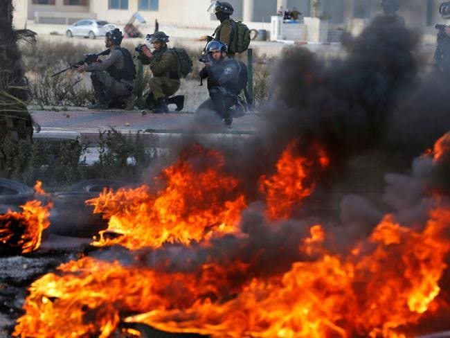 Israeli troops have been deployed to keep protests under control. Picture: AFP PHOTO / ABBAS MOMANI