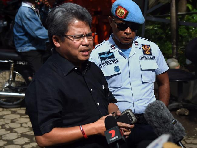 Appealed to leader ... Todung Mulya Lubis delivers a statement to the media at the port in Cilacap. Picture: AFP/ ROMEO GACAD