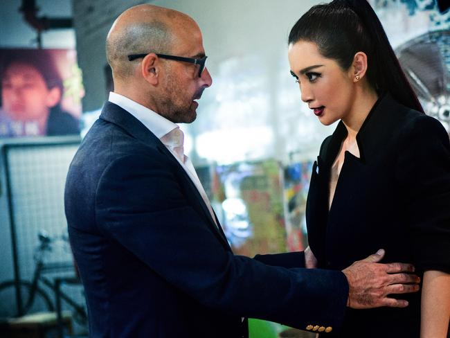 Stanley Tucci, left, as Joshua Joyce and Li Bingbing as Su Yueming, in Transformers: Age of Extinction.