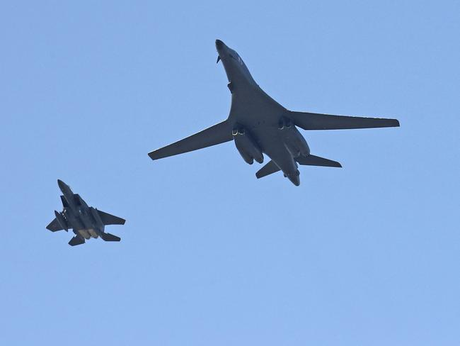 U.S. Air Force B-1B bomber, centre, and a South Korean fighter jet F-15K fly over the Seoul Airport where a site for the 2017 Seoul International Aerospace and Defence Exhibition. Picture: Yonhap via AP