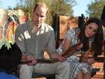 Prince William, Duke of Cambridge and his wife Catherine, Duchess of Cambridge inspect a snake made by Aboriginal elders during a visit to Uluru-Kata Tjuta Cultural Centre at Uluru. Picture: Getty
