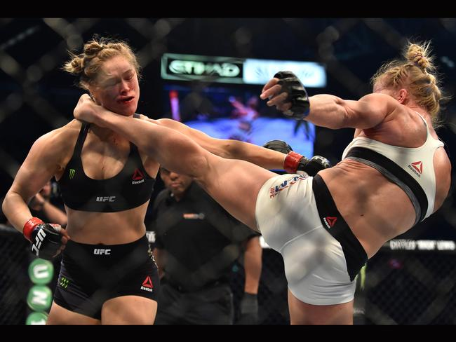 Holly Holm of the US (right) lands a kick to the neck to knock out compatriot Ronda Rousey and win the UFC title fight in Melbourne on November 15, 2015. Picture: Paul Crock/AFP