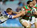 South Sydney's Greg Inglis bust the tackle off Bulldog's Trent Hodkinson during the NRL game between the Canterbury Bankstown Bulldogs and the South Sydney Rabbitohs at ANZ Stadium. Picture Gregg Porteous