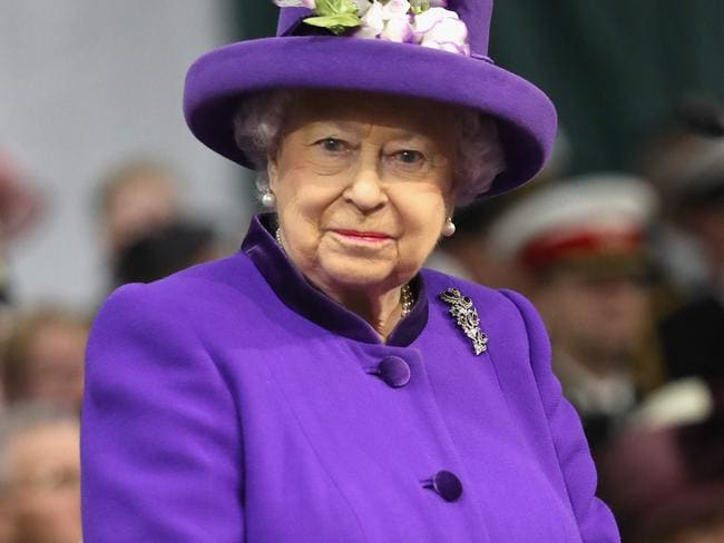 Britain's Queen Elizabeth II attends the Commissioning Ceremony for the Royal Navy aircraft carrier HMS Queen Elizabeth in December. Picture: AFP
