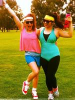 Kristy Volkova (left) and Amelea Fang are retro ready as they prepare to run in the 40th Chevron City to Surf for Activ.