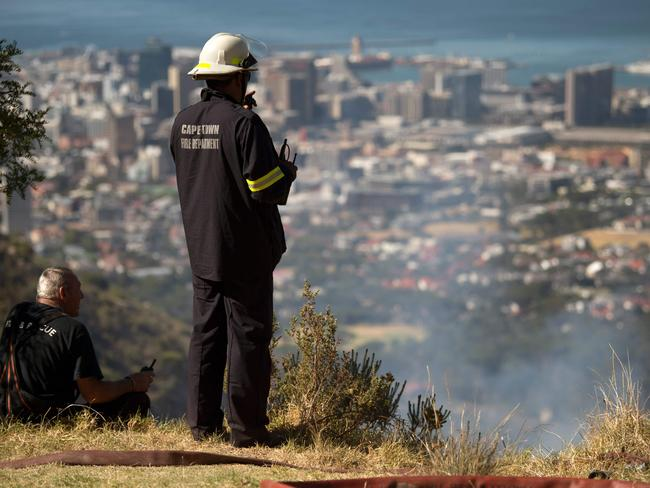 Firefighters monitor a fire on Table Mountain in Cape Town on January 28, 2018. Firefighting organisations face an especially difficult next few months as the risks of fires increase as the summer season reaches its hottest time. Picture: Rodger Bosch