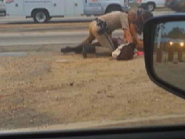 Pinned down ... The woman had been walking on Interstate 10 west of downtown Los Angeles when she was stopped by the officer. Picture: David Diaz