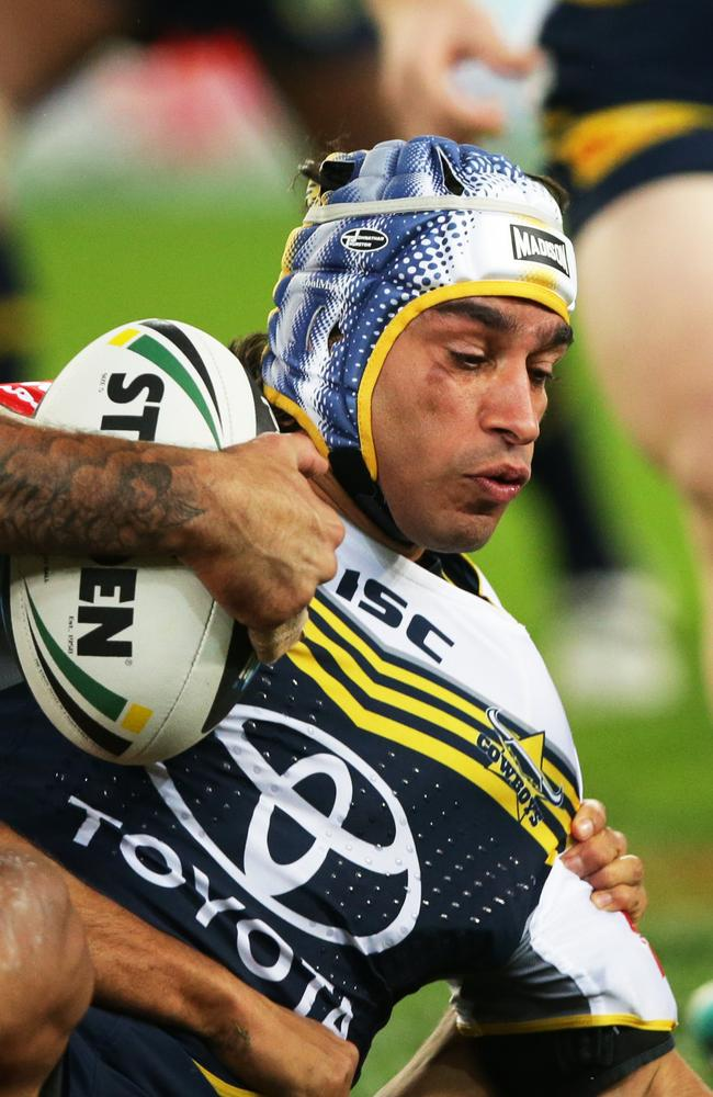 Cowboy's Johnathan Thurston is tackled to the ground.