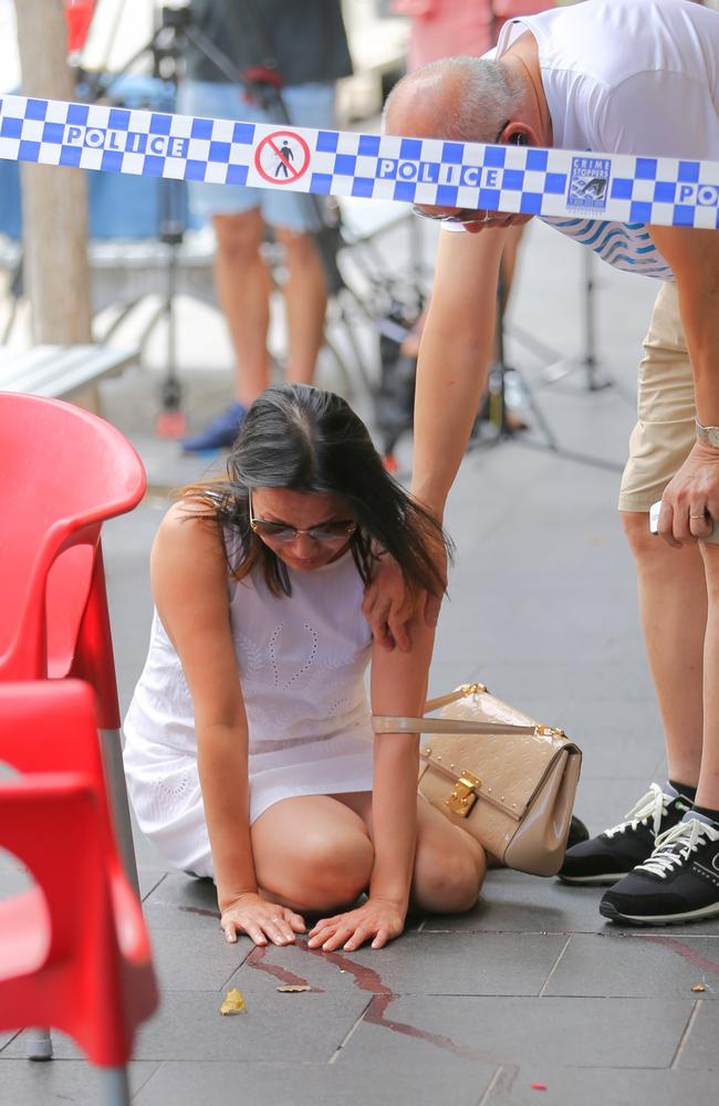 Vivian Vo, a friend of Mr Ledinh, breaks down at the site of the shooting. Picture: John Grainger