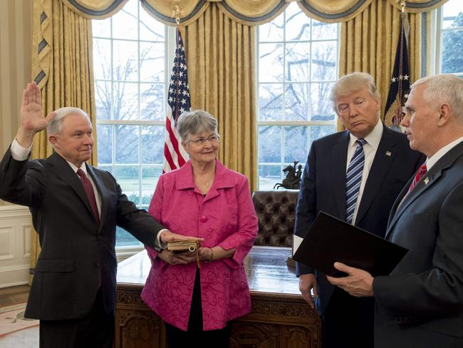 Mr Trump watches as Jeff Sessions, far left, is sworn in as Attorney General by US Vice President Mike Pence. Picture: AFP