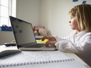 f34bully. Girl Using Laptop In Bedroom. generic for edu story on cyber bullying.Thinkstock