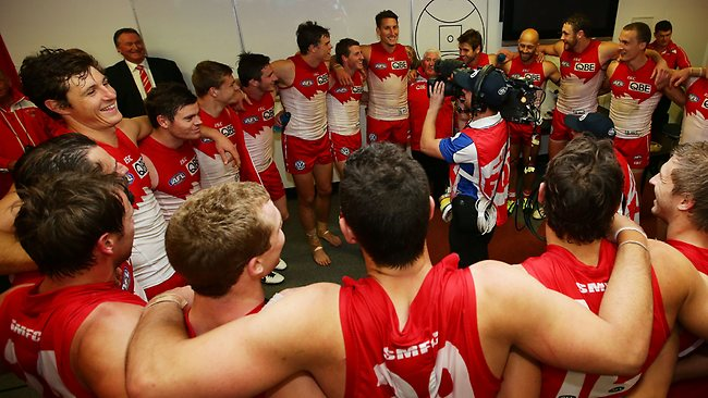 SYDNEY, AUSTRALIA - JULY 28: Swans players celebrate and sing the team song during the round 18 AFL match between the Sydney Swans and the Richmond Tigers at SCG on July 28, 2013 in Sydney, Australia. (Photo by Matt King/Getty Images)