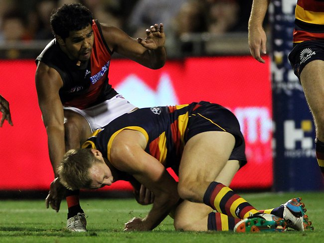 AFL round 1 - Adelaide Crows v Essendon Bombers at AAMI Stadium - Alwyn Davey gets the first free from Brent Reilly sliding in Picture: Simon Cross