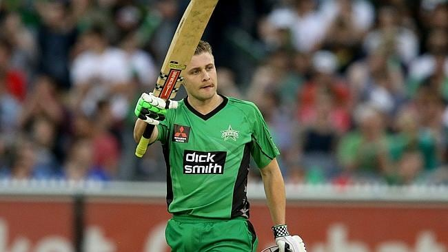 Luke Wright raises his bat after reaching his fifty.