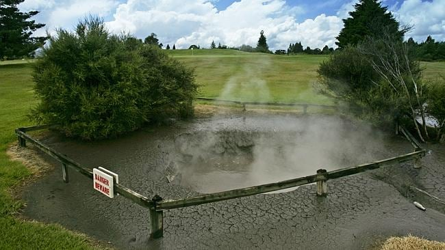 In the hazard ... A hot spring bubbles beside holes on the Rotorua Golf Club nine hole Thermal Course, in New Zealand. Pic: D...