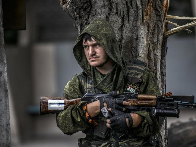 'Extremely dangerous' ... a pro-Russian separatist at the scene of intense clashes between Ukrainian government troops and pro-Russian rebels on the outskirts of Donetsk. Picture: Bulent Kilic