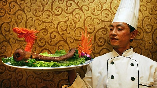 A cook poses with a plate of yak penis at the Guolizhuang Penis Restaurant, which offers more than 30 types of animal-penis dishes. Boy, that's a lot of penis. Photo: Getty