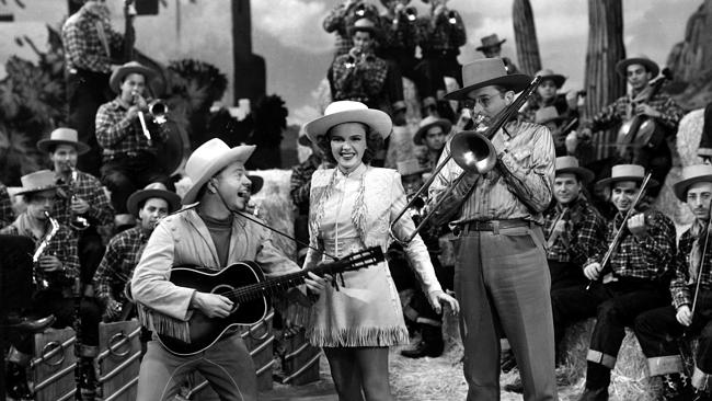 Singer Judy Garland sings I've Got Rhythm with Mickey Rooney and band leader Tommy Dorsey